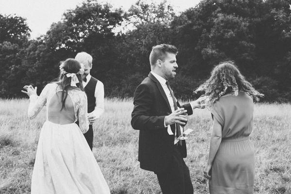 Wedding guests dancing in field