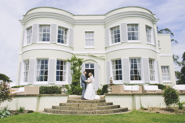 Bride and groom outside Deer Park Country House Hotel