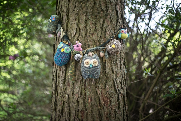 Soft toys tied to tree