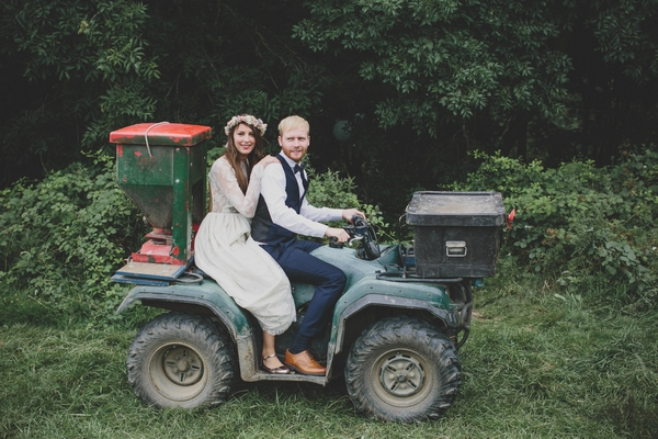 Bride and groom on quad bike