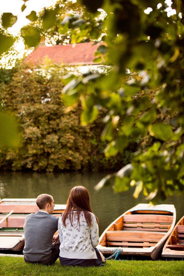 Man and woman sitting by river