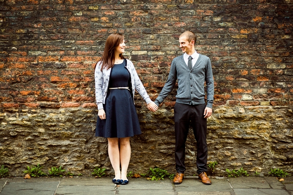 Couple standing in front of wall