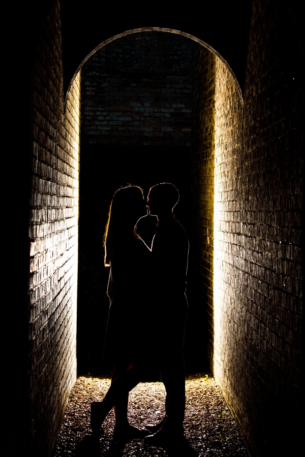 Silhouette of couple in alleyway