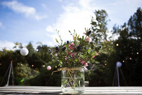 Jar of wedding flowers