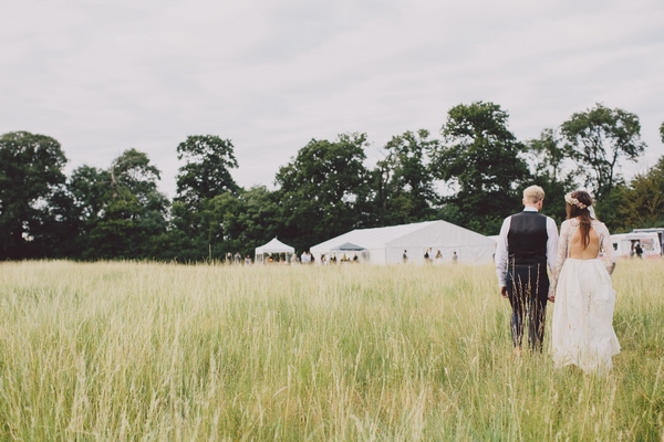 Bride and groom walking back to marquee