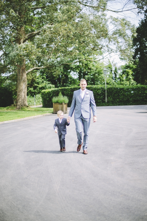 Groom walking with son