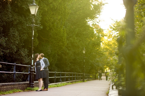 Couple kissing by lamp post