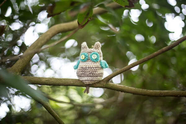 Knitted owl in tree