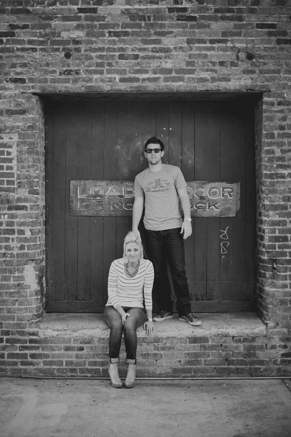 Engaged couple on wall