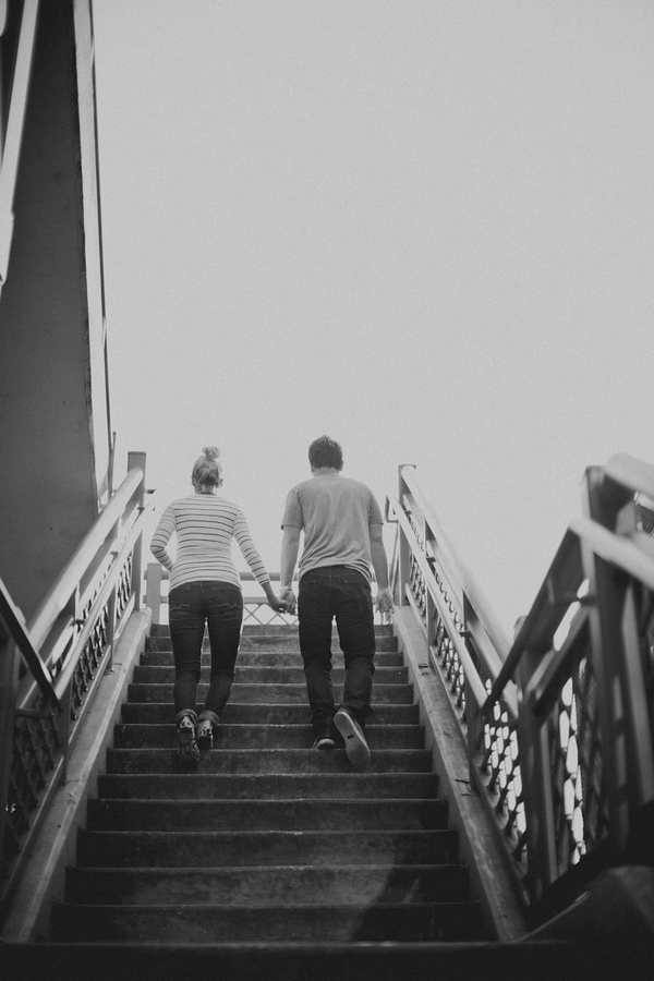 Engaged couple walking up steps