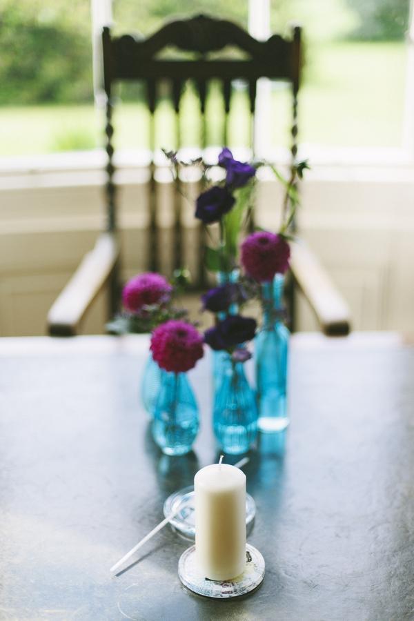 Blue bottles of flowers