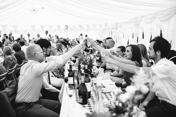 Wedding guests raising toast