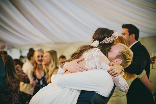 Groom lifting up bride on dance floor