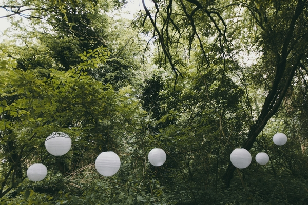 Paper lanterns hanging from trees