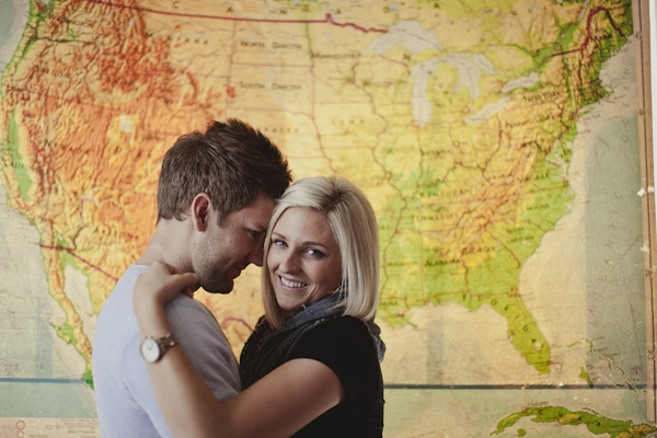 Engaged couple in front of map