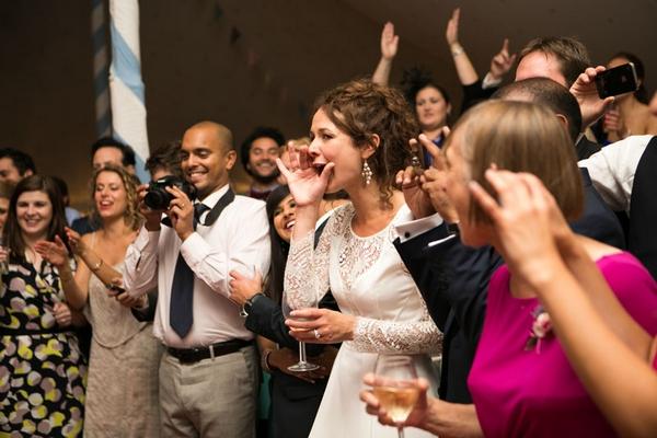 Guests watching Greek wedding dance