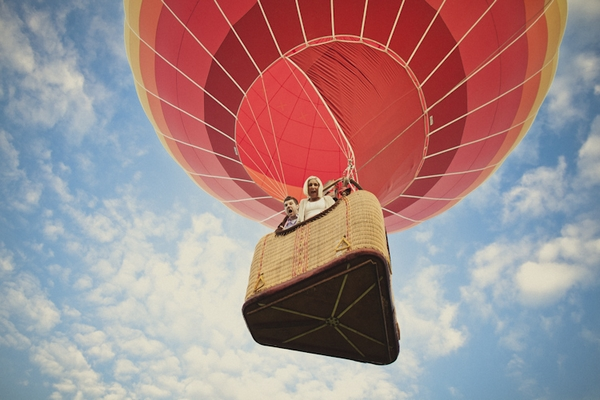 Engaged couple in hot air balloon