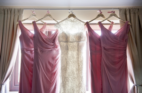 Wedding dress and bridesmaid dresses hanging