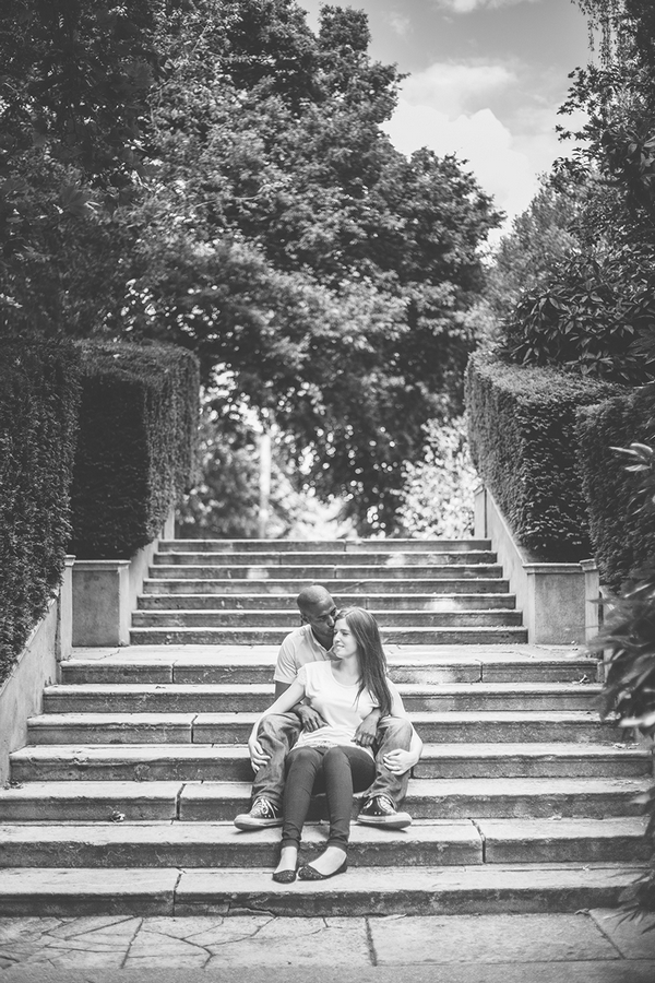 Couple sitting on steps in Holland Park