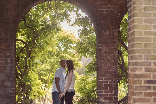 Couple under arch in Holland Park
