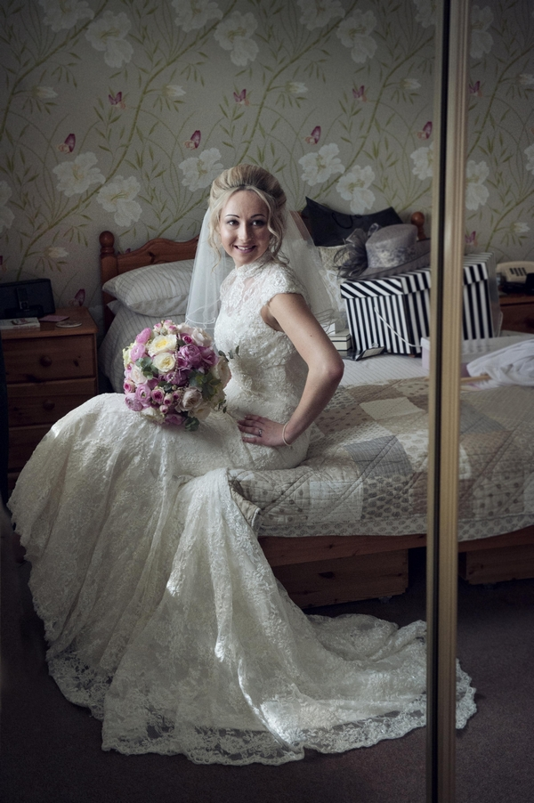 Bride sitting on bed