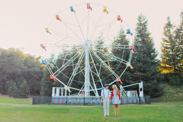 Man and woman in front of ferris wheel