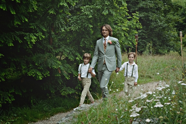 Groom walking with young boys