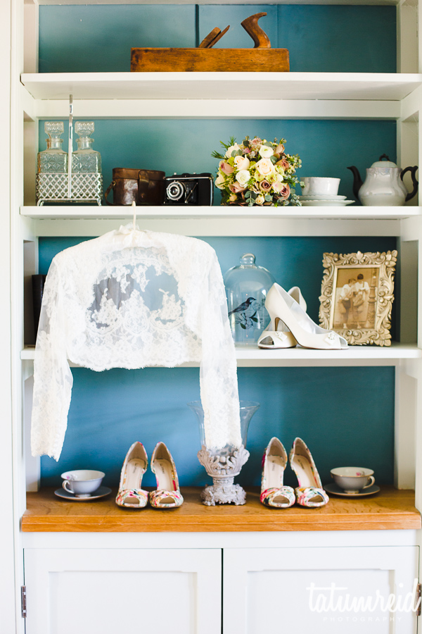 Wedding shoes and jacket on shelf