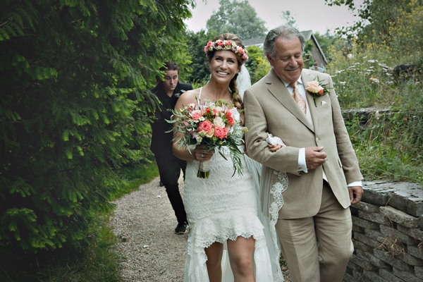 Father leading bride by arm