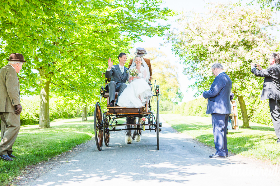Bride and groom on horse and cart