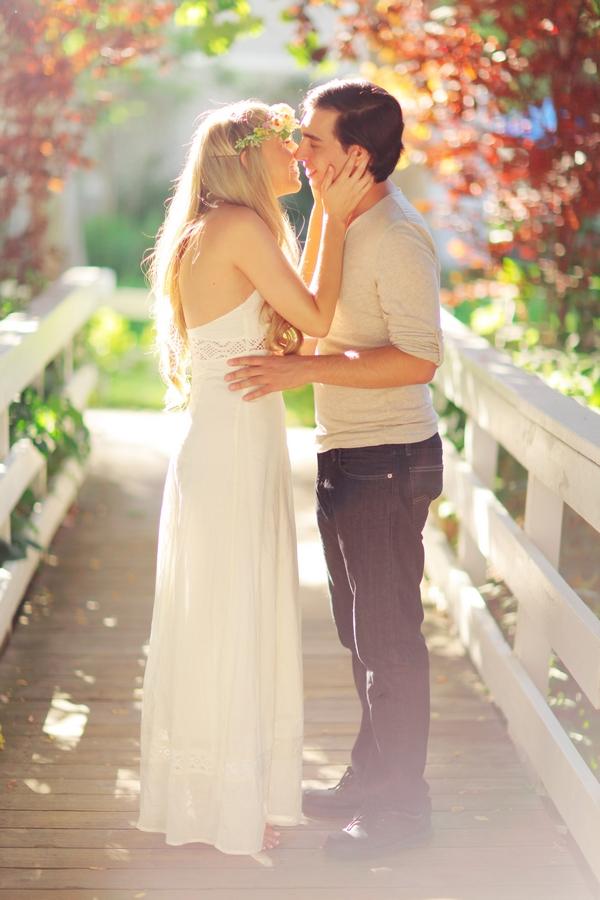Couple kissing on bridge