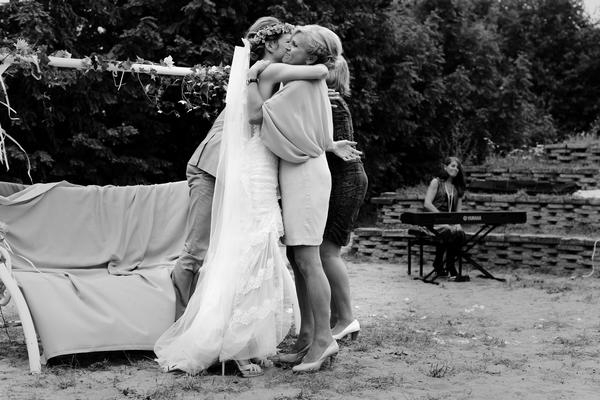 Bride hugging lady