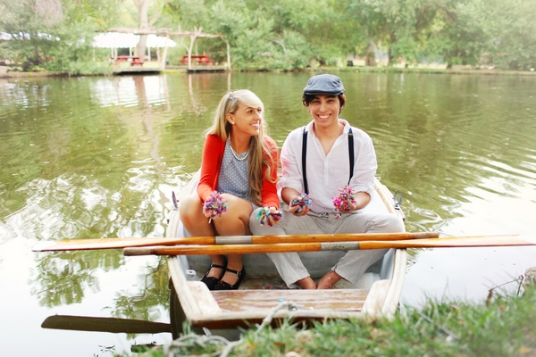 Couple on rowing boat about to throw confetti