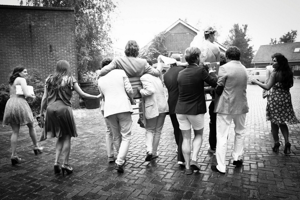 Bride and groom being carried