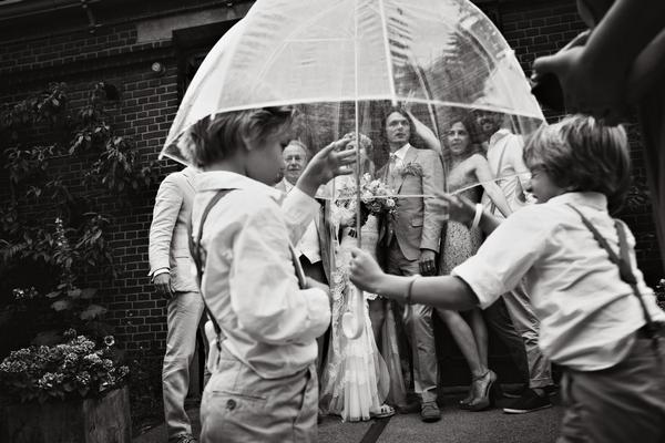 Wedding picture being taken behind umbrella