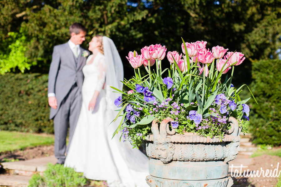 Bride and groom next to flowers