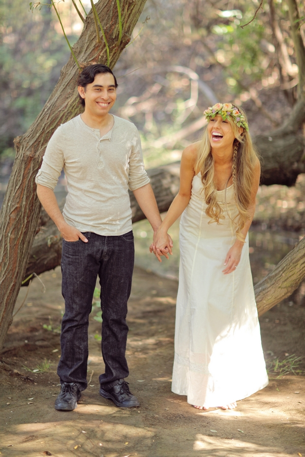 Couple holding hands laughing