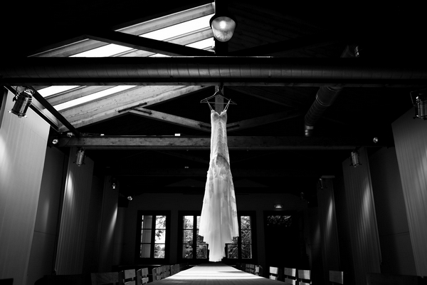 Wedding dress hanging from ceiling
