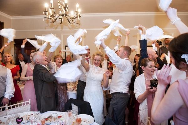 Wedding guests having napkins