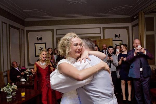 Emotional bride hugging father