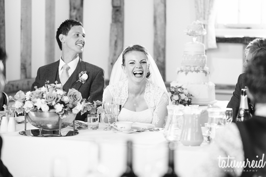 Bride laughing at wedding speech