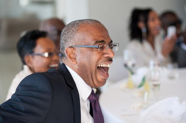 Man laughing at speech