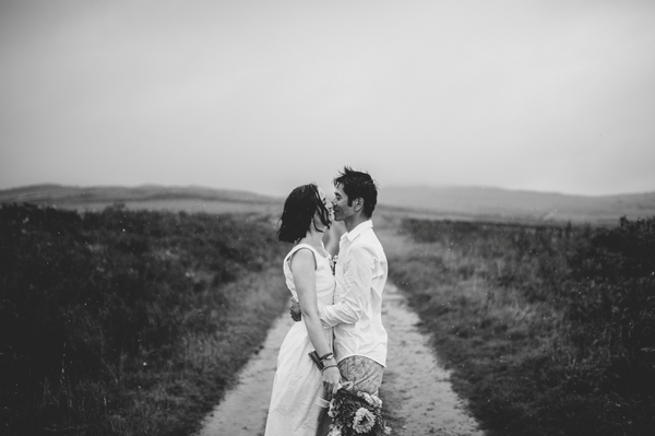 Bride and groom facing each other - Picture by Lisa Devine Photography