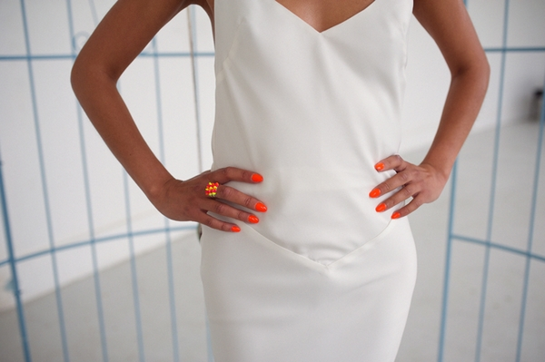 Hands on hips with bright finger nails