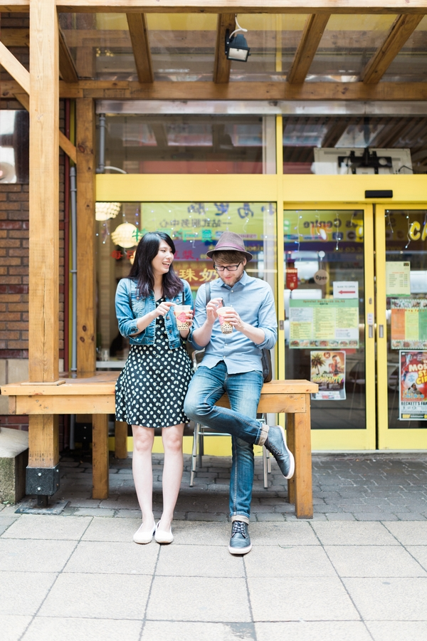 Couple outside shop with drinks
