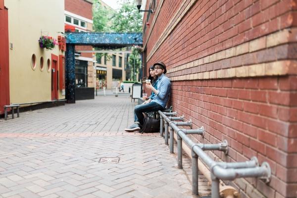 Couple sitting on railings