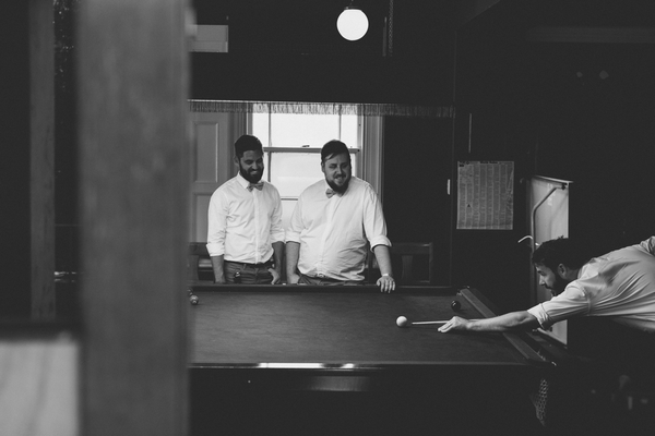 Groomsmen playing snooker