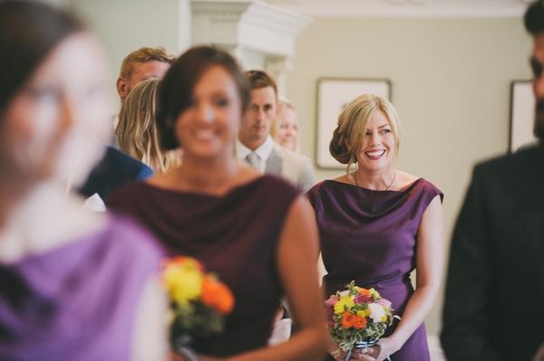 Bridesmaids entering wedding ceremony