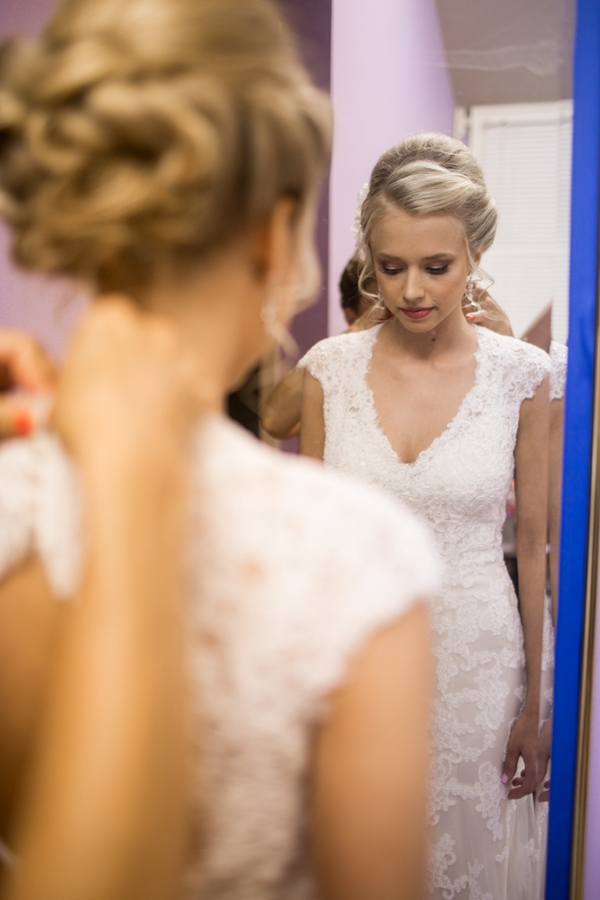 Bride standing in front of mirror
