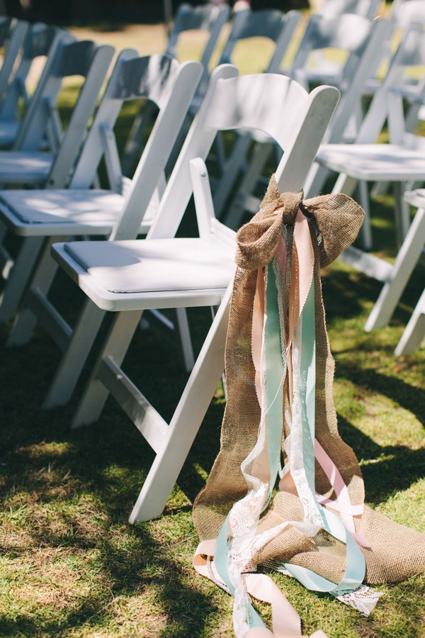Streamers tied to wedding chair